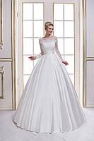 Свадебное платье с кружевным лифом и длинными рукавами является образцом сдержанной роскоши и благородства