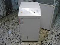 Стиральные машины Miele c вертикальной загрузкой