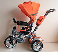 Детский трехколесный велосипед оранжевый с поворотным сидение