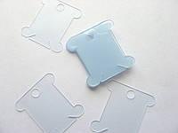 Бобінка пластикова для зберігання муліне. Блакитна, 36х40 мм