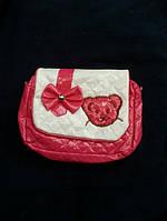 Модная лаковая детская сумочка розового цвета