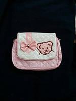Нежная лаковая детская сумочка розового цвета