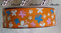 Лента репсовая декоративная оранжевая с рисунком бабочки шириной 2,5 см
