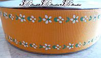 Лента репсовая декоративная оранжевая с рисунком цветы кромка шириной 2,5 см