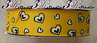 Лента репсовая декоративная ярко-желтая с рисунком сердечки шириной 2,5 см