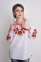 Красивая женская вышитая блуза в красной гамме