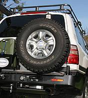 Выносной крепеж запасного колеса KAYMAR к заднему бамперу Toyota Land Cruiser 105
