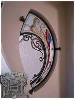 Декоративне коване обрамлення для вікна