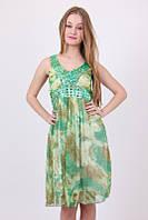 Модное платье для стильных дам зеленого цвета