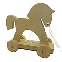 Игрушка-каталка, лошадка на колесах деревянная