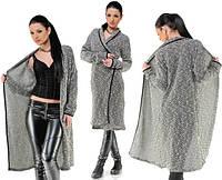 Женская длинная кофта с окантовкой из эко кожи.