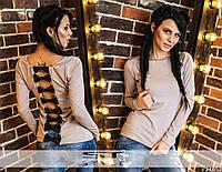 Женская кофта с кожаными бантиками на спине