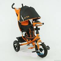 Детский трехколесный велосипед с надувными колесами и фарой оранжевый Best Trike 06588-В