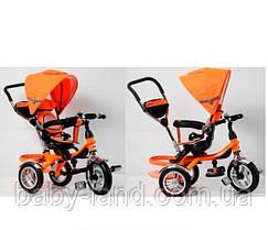 Детский трехколесный велосипед с надувными колесами и поворотным сиденьем TR16004 оранжевый