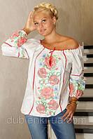 Модная женская блуза с вышивкой.