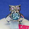 Серебряное кольцо Сова с голубым цирконом 1090г