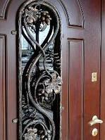 Двери входные с ковкой и стеклопакетом