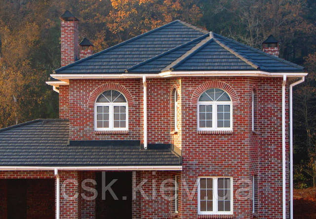 Дом с крышей из композитной черепицы Metrotile