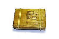 Шу Пуэр завёрнутый в листья бамбука 2005 г. 250 гр. Фабрика Фэн Цин