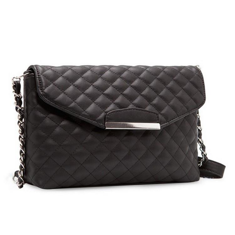Женская сумка клатч Mango стеганая черного цвета
