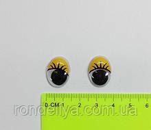 Глазки с подвижным зрачком желтые 14 х 18 мм