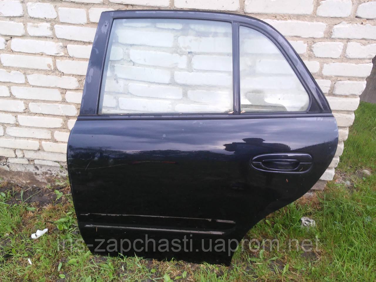 Дверь задняя левая  Mazda 626 cедан 1998-2002