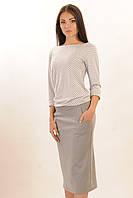 Зауженная юбка длиной ниже колена - миди, по бокам два кармашка 42-52 размера