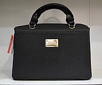 Женская сумка с оригинальным замком