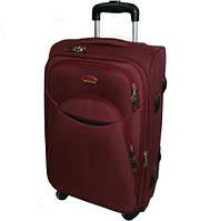 Большой дорожный чемодан на четырёх колёсах фирмы SUITCASE