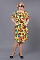 Изящное летнее платье желтого цвета из льна с красочным рисунком