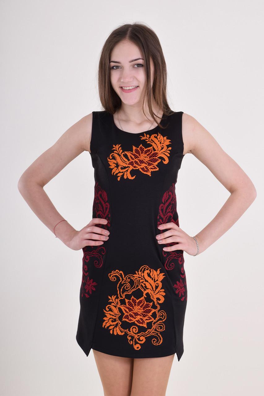 Изысканное черное платье из мягкого трикотажа декорировано вышивкой