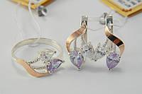 Набор серебряных украшений с фианитами - кольцо и серьги.