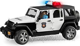 Игрушка Bruder  Внедорожник Jeep Wrangler Unlimited Rubicon Полиция с фигуркой полицейского 1:16  (02526)
