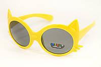Детские очки в желтой оправе оригинальной формы