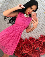 Платье с перфорацией и расклешенной юбкой