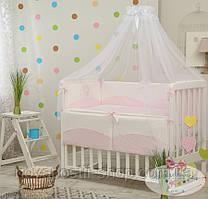 Набор в детскую кроватку Tutty розовый (7 предметов)
