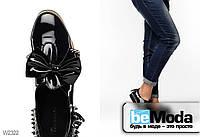 Лакированные туфли Girnaive Bow с элементами кантри стиля, украшенные бантом, бахромой и шипами чёрные