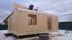 Возведение стен первого этажа, установка перегородок и укладка панелей межэтажного перекрытия.