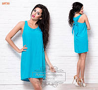 Голубое платье с бантом на спине