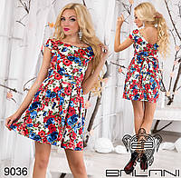 Женское  летнее  платье с пышной юбкой и вырезом на спине.