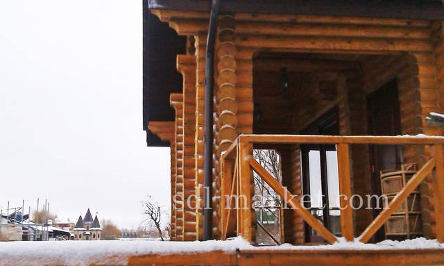 Киевская обл., Дамба, 3-й км. Декоративные работы по срубу.