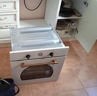 Извлечение встроенного духового шкафа из мебели