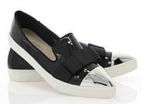 Модная и стильная женская обувь слипоны на танкетке и платформе ADELINE