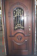 Двері вхідні металеві з дубовими плитами і склопакетом