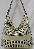 Стильная женская сумка из натуральной кожи.