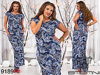 Легкое женское  платье с заниженной талией и с карманами.