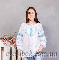 Красивая женская  вышиванка вышита крестиком в сине голубыми нитками.
