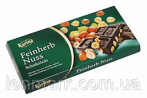 Черный шоколад Karina «Feinherb Nuss» с цельным лесным орехом 200 г