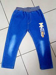 Детские джинсы, разрисованные карманы.