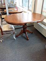 Раздвижной стол из дерева.